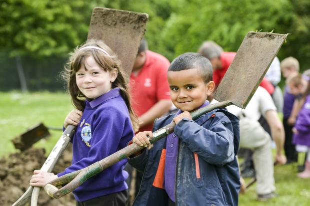 This Is Wiltshire: Children at Goddard Park dig a trench as part of their commemoration of the First World War