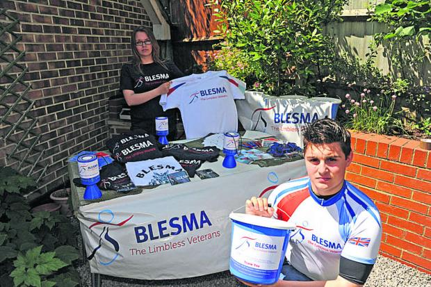 This Is Wiltshire: John Phillips and Poppy Foss set up a stall for BLESMA, the charity which has helped his father Andy
