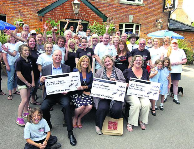 This Is Wiltshire: Steve Goodrick, fundraising manager for Macmillan, Tracey Mallingson, area fundraiser for Macmillan, Sarah Talbot Williams (Above & Beyond), Liz Sharpe (chairman of the parish  council)  with their cheques and all the crew and regulars