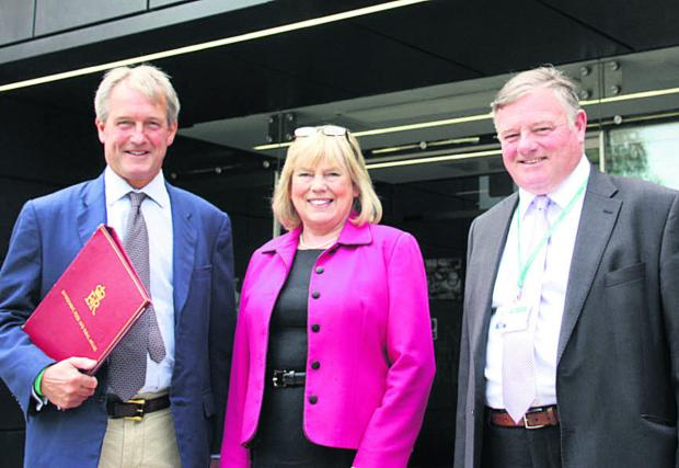 This Is Wiltshire: Floods minister Owen Paterson with Wiltshire Council leader Jane Scott and Coun Jonathon Seed
