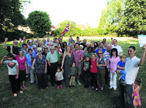 This Is Wiltshire: Paul Adams, right, and other residents celebrate victory in their efforts to protect The Circle