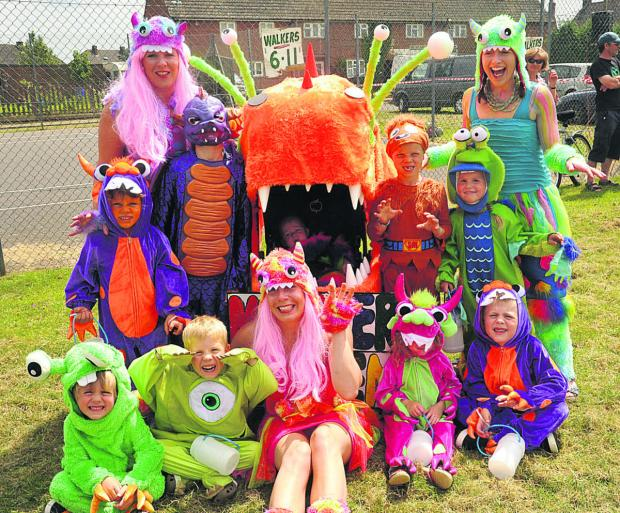 This Is Wiltshire: Fluffy orange alien to yellow Minions and bright green Shrek family at Bromham Carnival