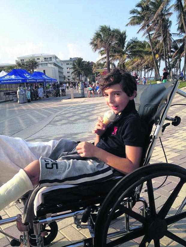 This Is Wiltshire: Luca Railton, who has been having physiotherapy three times a week in Boca Raton, Florida