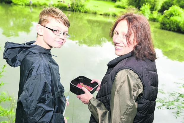 This Is Wiltshire: Jake Evans with his mother Sue at Jubilee Lake for the Royal Wootton Bassett Academy's fishing competition