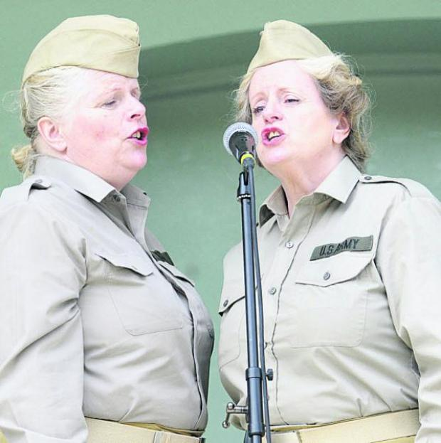 This Is Wiltshire: US  Army girls Isobel King and Annette Wells during the 1940s road show. Picture by Trevor Porter