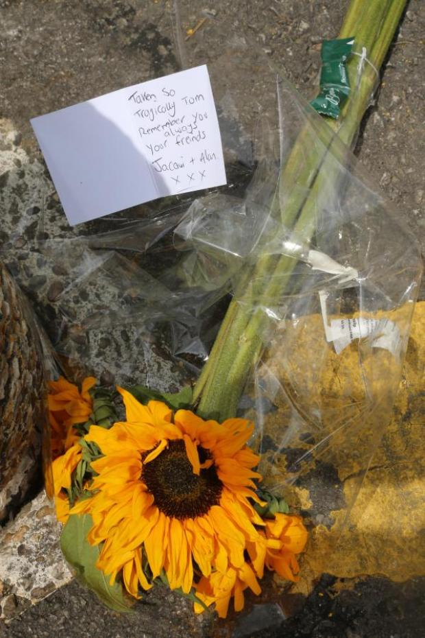 This Is Wiltshire: Flowers at the scene of Tom Rogers' murder