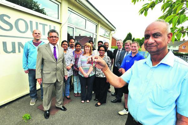This Is Wiltshire: Swindon Council hands over the keys to Park South Community Centre to Ram Thiagrarajah, of the Swindon Tamil Association
