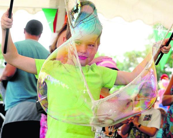 This Is Wiltshire: Sam Stickley makes giant bubbles at last year's Stratton Festival