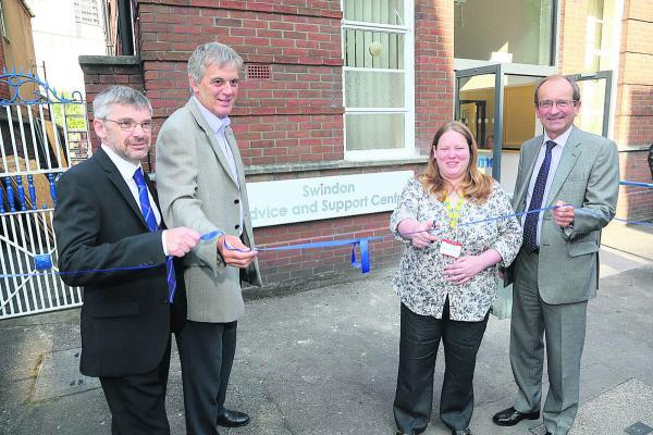 This Is Wiltshire: Sanford House has re-opened as the Swindon Advice and Support centre. Cutting the ribbon are, left to right, Paul Bearman, Director of commissioning for CCG, David Wray, Chief Executive of Voluntary Action Swindon, Claire Newport, Chief Executive of Citiz