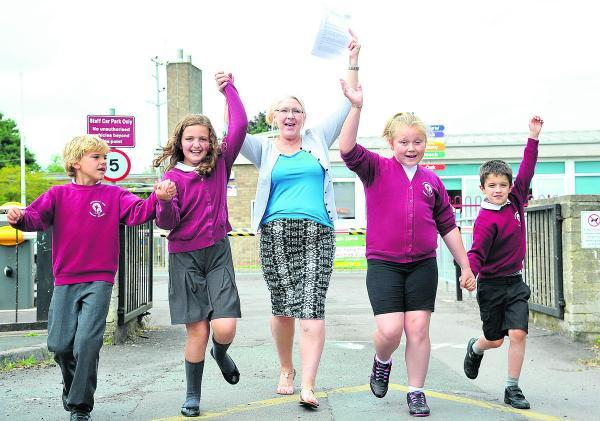 This Is Wiltshire: Covingham Park Primary School has made rapid improvements following an Ofsted inspection last month. From left, Dylan, Madison, Debbie Hughes, Ella and Liam