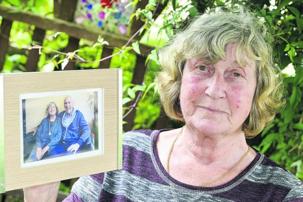 This Is Wiltshire: Wendy Curtis with a photo of her brother Glynn Uzzell who died in a gas explosion at his home in Portugal