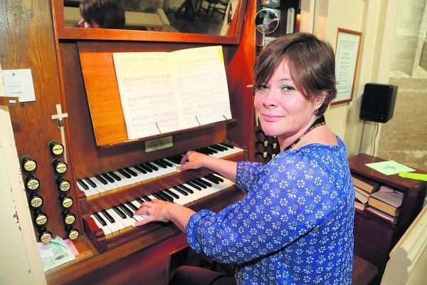This Is Wiltshire: Sarah Townsend, the director of music for St Sampson's Church plays the organ which has been damaged by bat droppings