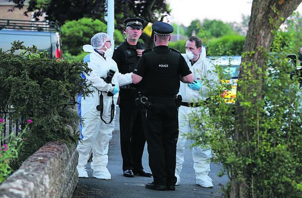 This Is Wiltshire: A forensics team at work at the scene of the arrest at Southbrook Street extension