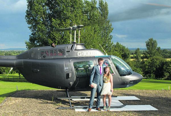 This Is Wiltshire: Edward Mayhew and Charlotte Holland fly in to Cricklade House Hotel for Malmesbury School's Year 13 prom