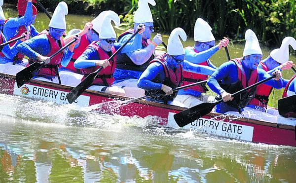 This Is Wiltshire: Team North give their all in last year's dragon boat races in Monkton Park, Chippenham