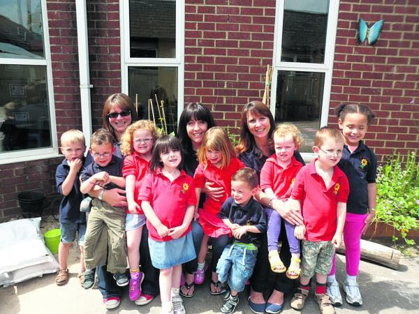 This Is Wiltshire: Staff members Sabeana Shimer, Tracey Fletcher and Nicola Bayly with some of the children