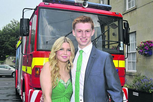 This Is Wiltshire: George West and Hannah Jordan arrived in a fire engine for the John of Gaunt Year 11 prom. Picture by Glenn Phillips