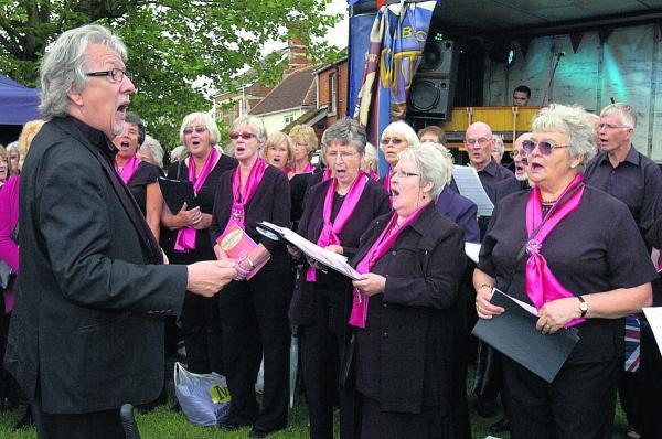 This Is Wiltshire: Grenville Jones leading the Devizes Good Afternoon Choir as part of the Que