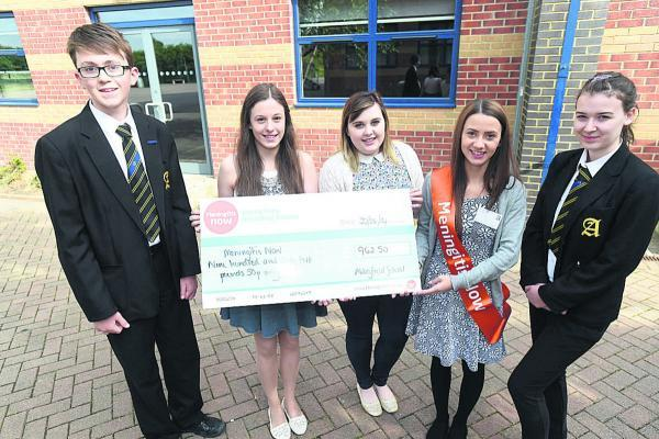 This Is Wiltshire: Sam Goring, Year 10, Kate Tyrer, Year 12, Emily-Jane Anslow, Year 12, Leah Wynn, Meningitis Now community fundraiser and Brittany Robbins, Year 10, with cheque