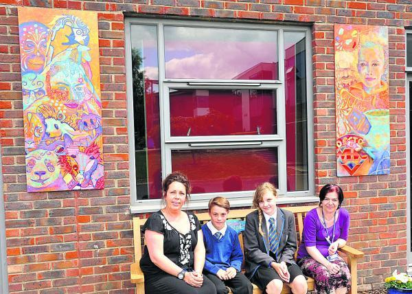 This Is Wiltshire: John Bentley School in Calne has put up a remembrance bench with artwork either side in memory of ex-pupil, Tylor Stevens. From left are art teacher Emma Bennett, Laurence Bruce, Abbie Lovelock and teaching assistant Ann Brock