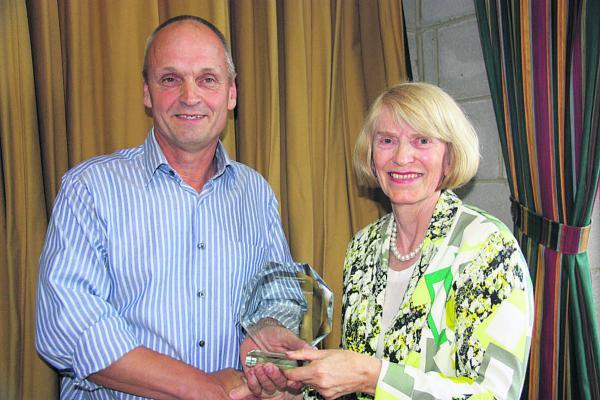 This Is Wiltshire: Alan Brinkworth collects his award from Councillor Linda Packard