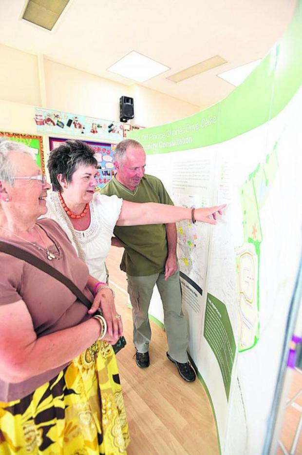 This Is Wiltshire: From left, residents Frances Snell, Carol Porteous and Michael Bright look at the plans