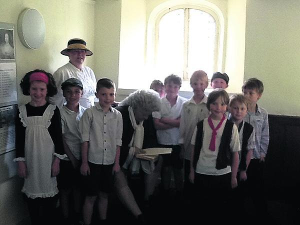 This Is Wiltshire: Dressed in pinafores and waistcoats, the pupils looked the part