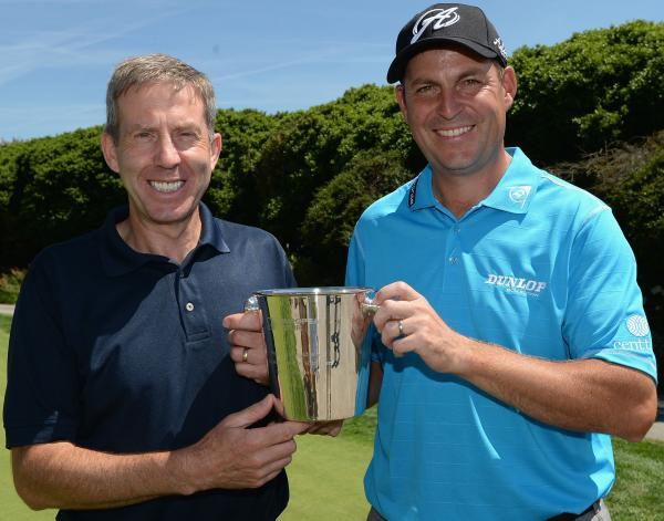 This Is Wiltshire: David Howell (right) is presented with an engraved ice bucket by Keith Waters, The European Tour's Chief Operating Officer