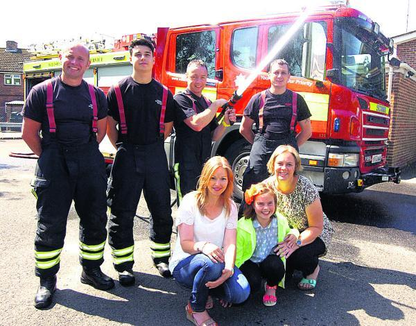 This Is Wiltshire: Niki Conner, Liz Grey with daughter Isobel, and Nick Borritt, Zac Messenger, Mark Hillier and Andy Olsen at Pewsey fire station