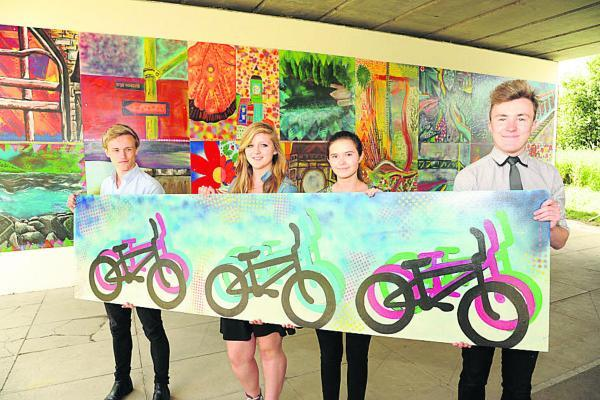 This Is Wiltshire: Some of the Clarendon Academy A-level art students who made the murals: from left, Ricky Griggs, Lucy Winterbottom, Rebecca Taylor and Charles Stone