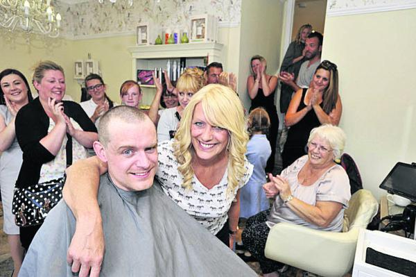 This Is Wiltshire: Hairdresser Richard Gardner after his mum, Julie, took the clippers to his hair