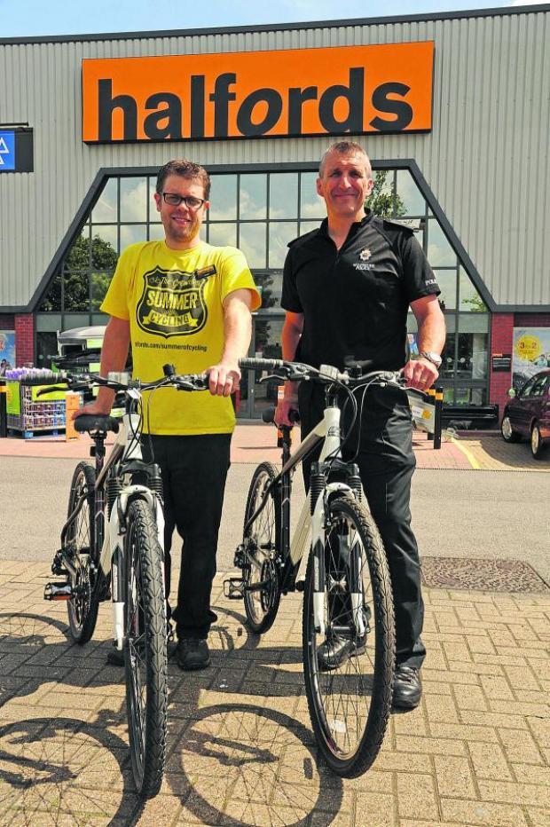 This Is Wiltshire: Adam Leitch, of Halfords, hands over two bikes to Inspector Chris Chammings