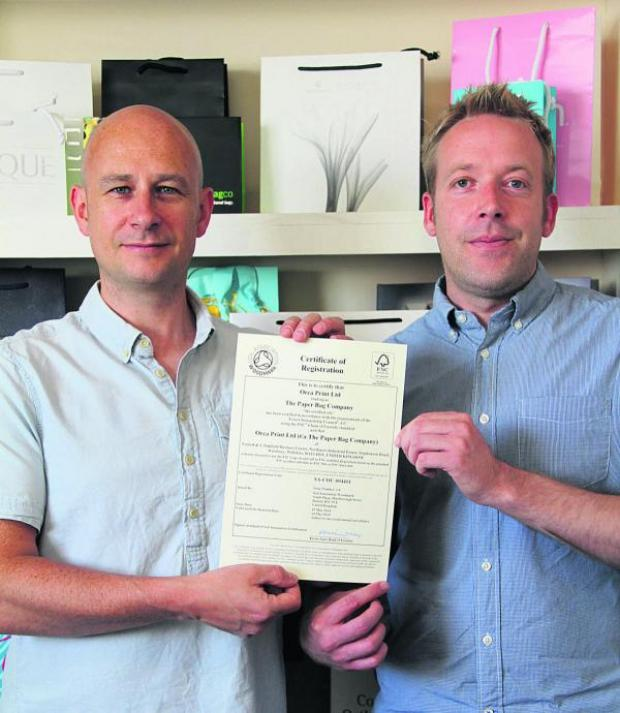 This Is Wiltshire: Jon Marling, left, with the certificate and Jim Garven, commercial director of the company