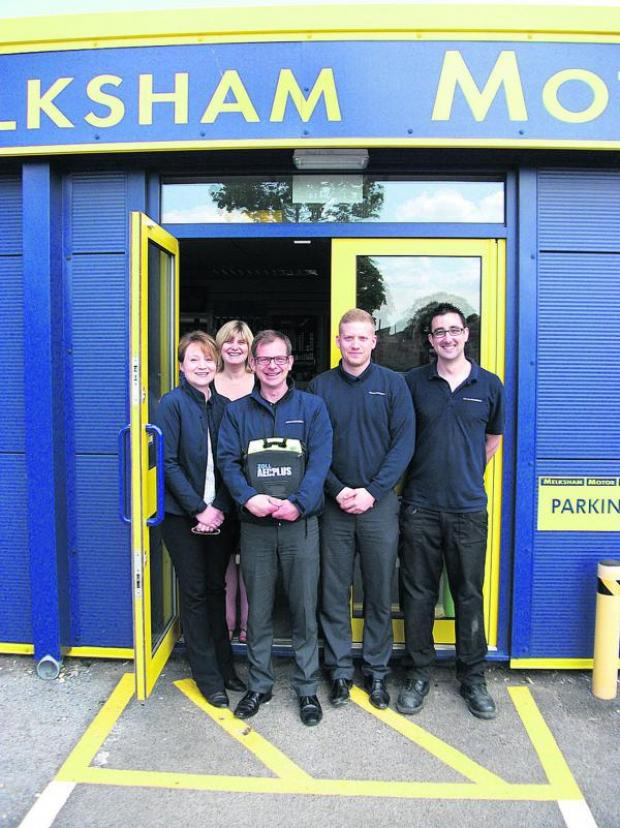 This Is Wiltshire: The staff of car spares firm Melksham Motor Spares with the new defibrillator which it has installed