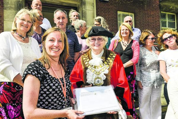This Is Wiltshire: Coun Nadine Watts, Old Town, handing the Croft Fields petition to Swindon Mayor Teresa Page