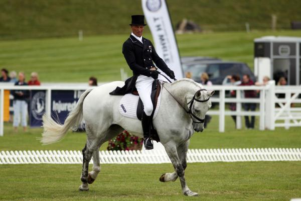This Is Wiltshire: Andrew Nicholson and Avebury compete in the dressage at Barbury today