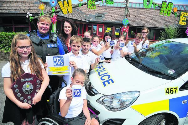 This Is Wiltshire: PSCO Mandi Coles with Sarah Sumner and pupils at Westlea Primary School after presenting their prize