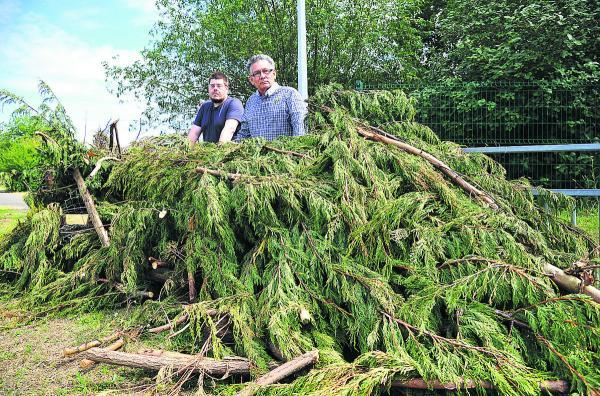 This Is Wiltshire: Councillors Neil Heavens and Derique Montaut peer  over the green waste