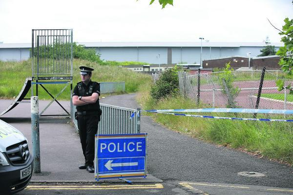 This Is Wiltshire: A police officer guards the scene after the discovery of the body of Tom Rogers