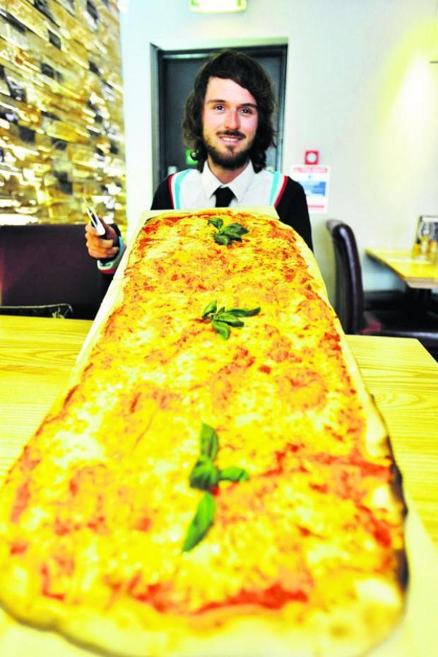 This Is Wiltshire: Reporter Craig Jones about to take on his pizza challenge at Rustico
