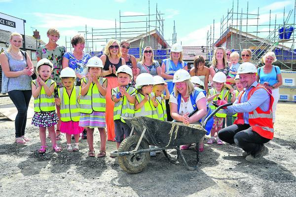 This Is Wiltshire: Pupils watch new school take shape