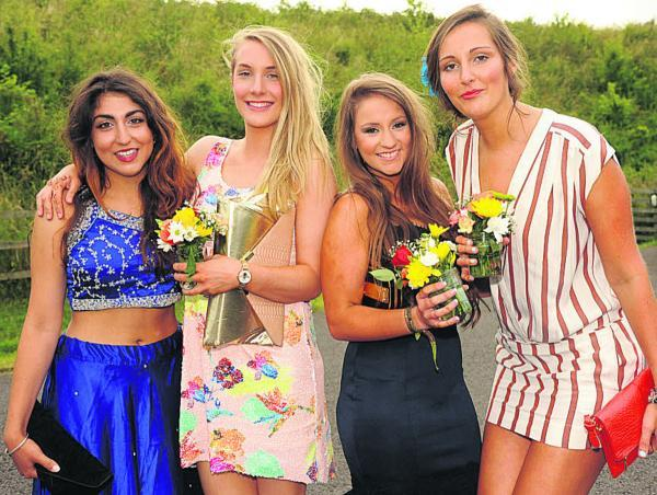 This Is Wiltshire: Girls arrive at the St Laurence sixth form prom at Wick Farm. Picture by Trevor Porter