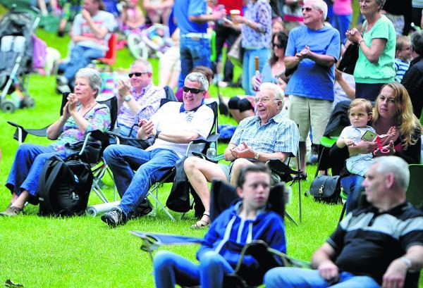 This Is Wiltshire: Crowds enjoy the music at the Old Town Bowl on Saturday