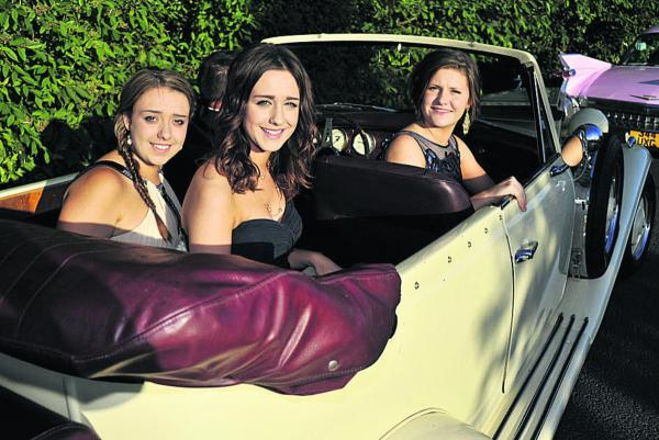 This Is Wiltshire: Antonia Painter, Hannah Poulton and Casey Lee arrive in a 1936 Beauford for the Kingsdown School Year 11 prom. Picture by Glenn Phillips