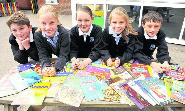 This Is Wiltshire: Bishops Cannings School pupils have won 100 books after reading more than 900 books in a national challenge. From left are Arthur, Chloe, Chloe, Sapphire and Lenny. (VS443) Picture by Vicky Scipio