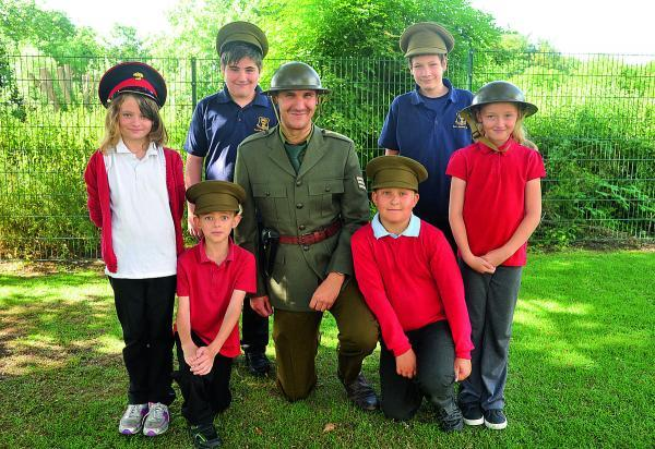 This Is Wiltshire: WW1 centenary event from pupils at Oaktree and Lainesmead School. From left, Maria (standing), Lewis, Nick Croxford, Jack and Elle-Leigh (standing). Back, Campbell and Rhys from Year 9