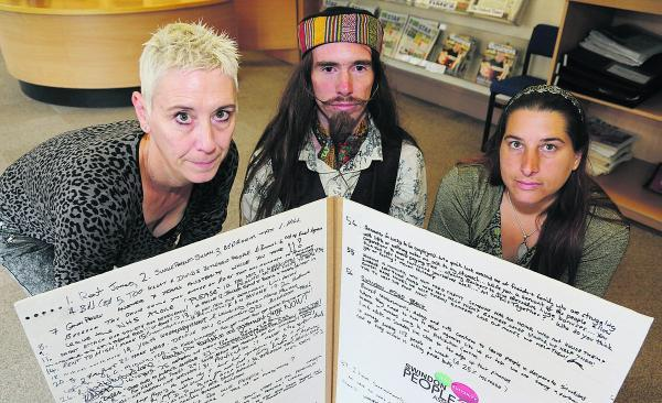 This Is Wiltshire: Members of Swindon's People's Assembly pictured with a petition which they are handing in to David Cameron at No10 next week. Left to right, Kate Linnegar, James Yeowell and Angel Grace