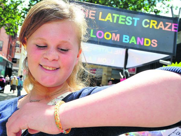 This Is Wiltshire: Nova Hreod pupil Caitlin Humphries is a big fan of loom bands and is pleased her school has not banned them  Picture: DAVE COX