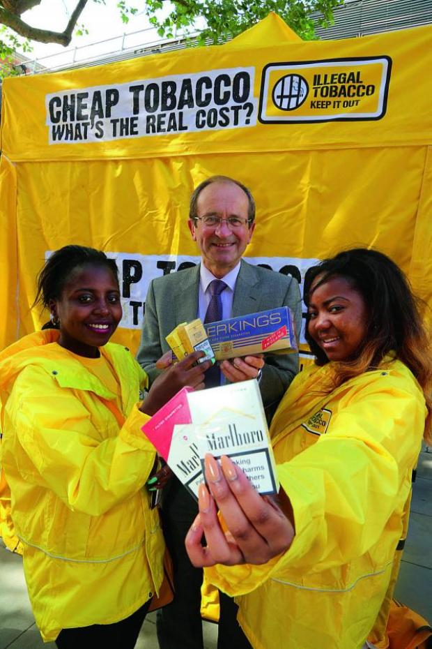 This Is Wiltshire: Smokefree event team members Debra Mumbi-Peterson and Tianna Esson pictured with Swindon council deputy leader Brian Mattock