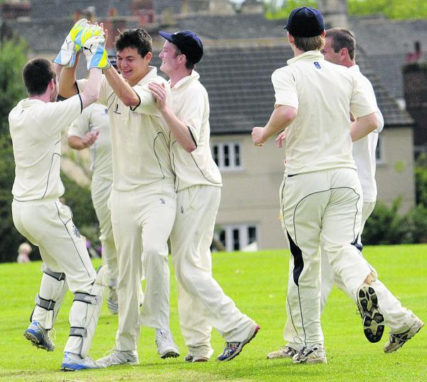 This Is Wiltshire: Celebrations for Malmesbury after taking the wicket of Beanacre & Melksham's Mark Wiltshire during Saturday's Division One match that Malmesbury won by 149 runs    (50075-6)